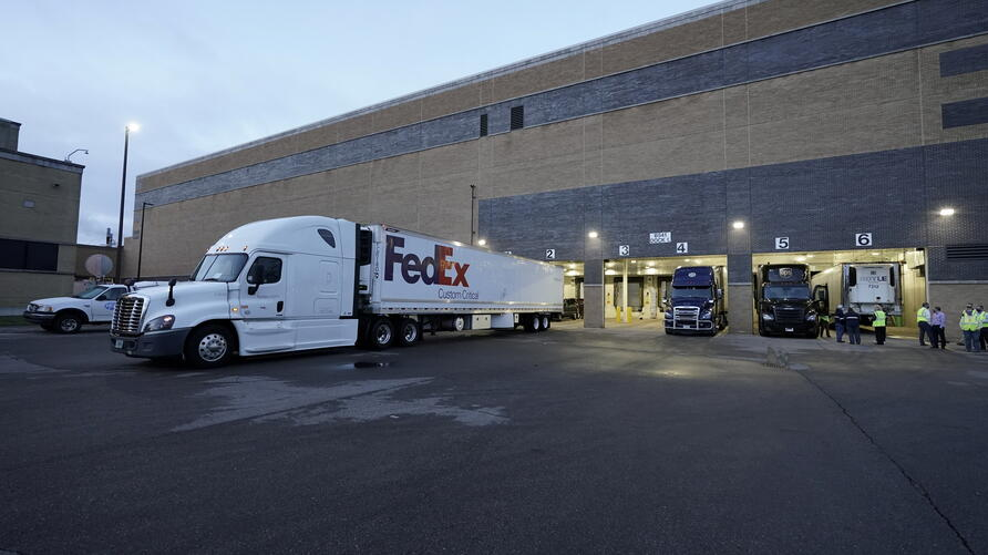 A FedEx truck sits in the dock at the Pfizer Global Supply manufacturing plant in Portage