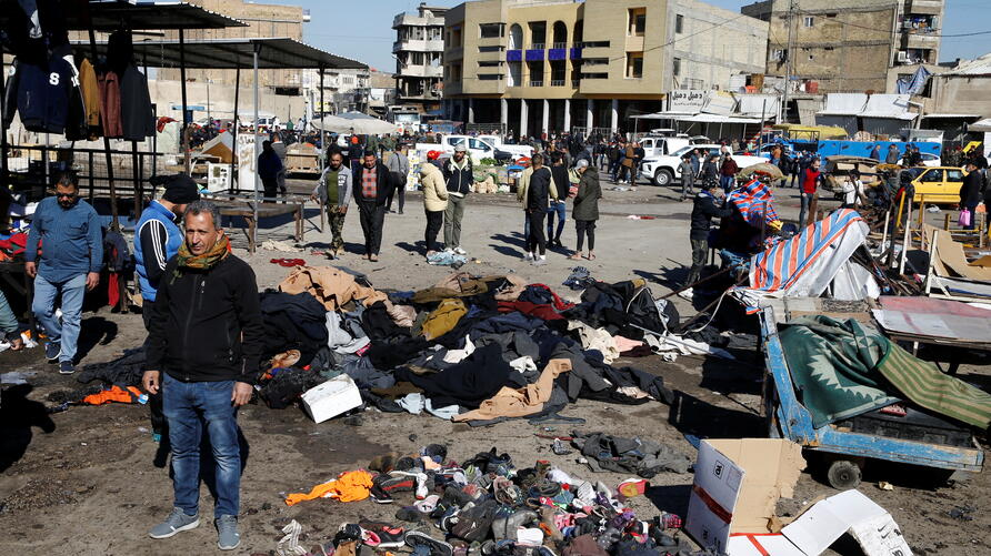 The site of a twin suicide bombing attack in a central market is seen in Baghdad