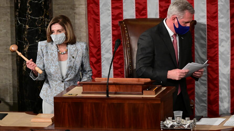 Speaker of the House Nancy Pelosi holds the Speaker's gavel after winning re-election as Speaker of the 117th Congress in Washington