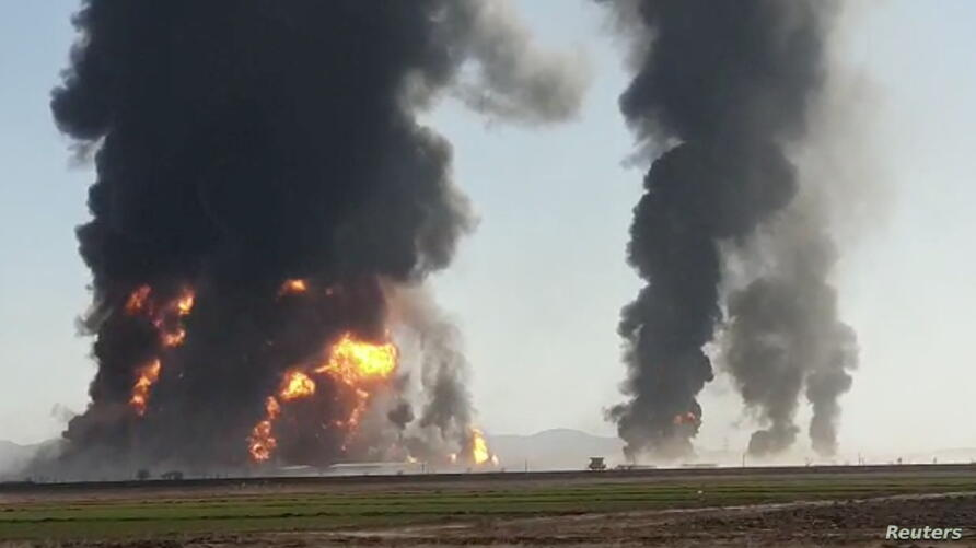 Fire and smoke rise from an explosion of a gas tanker in Herat