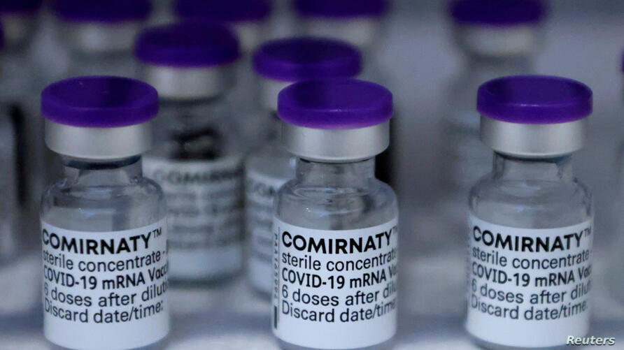 FILE PHOTO: Injections with doses of the Pfizer-BioNTech Comirnaty coronavirus disease (COVID-19) vaccine are pictured in Berlin