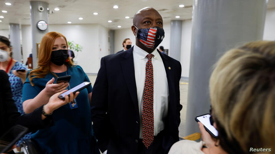 U.S. Senator Scott speaks with reporters as he transits the subway system beneath the U.S. Capitol in Washington