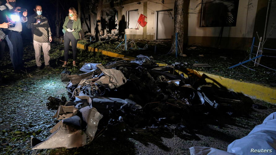 The remains of a car bomb that exploded inside a military base are seen in Cucuta