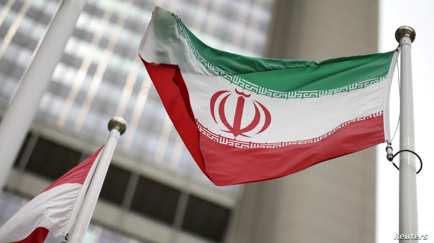 Iranian flag flies in front of the UN office building in Vienna
