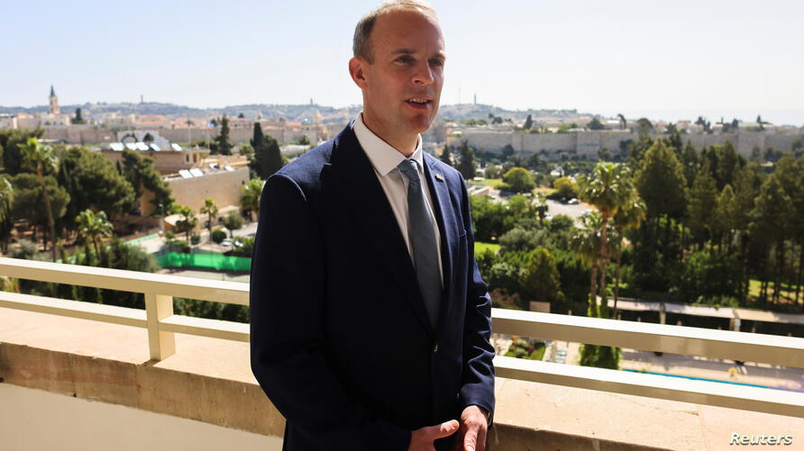 Britain's Foreign Minister Dominic Raab looks on during his interview with Reuters in Jerusalem