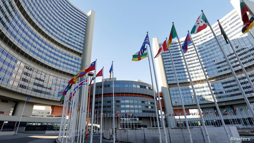 Flags are seen in front of the International Atomic Energy Agency (IAEA) headquarters, in Vienna