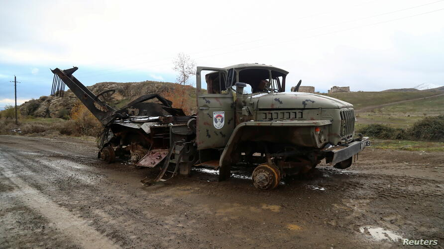 FILE PHOTO: A view shows a damaged truck of ethnic Armenian forces in Jabrayil District