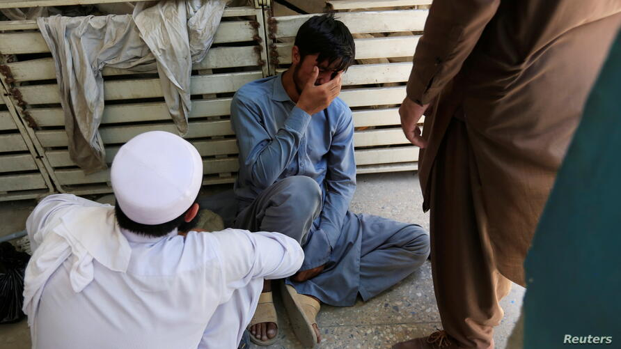 An Afghan man cries for his brother who was one of polio vaccination health workers shot and killed by unknown gunmen at separate locations in Jalalabad