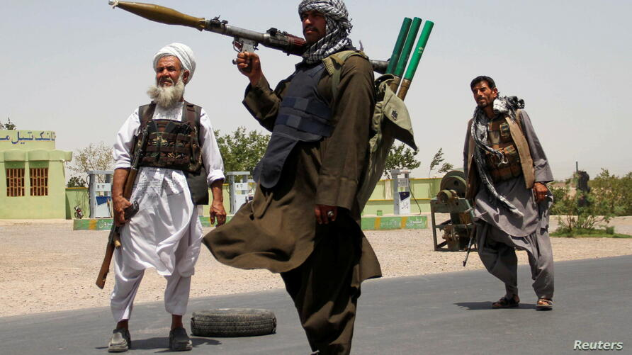 Former Mujahideen hold weapons to support Afghan forces in their fight against Taliban, on the outskirts of Herat province