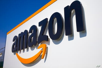 The Amazon logo is seen in Amazon, in Douai, northern France, Thursday April 16, 2020. Amazon has decided to suspend …