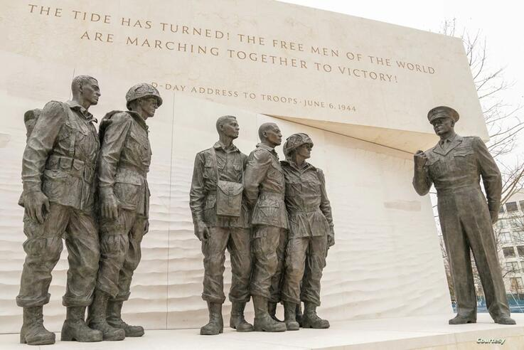A group of statues at the memorial recreates the photo of Gen. Dwight D. Eisenhower speaking with paratroopers before they go to