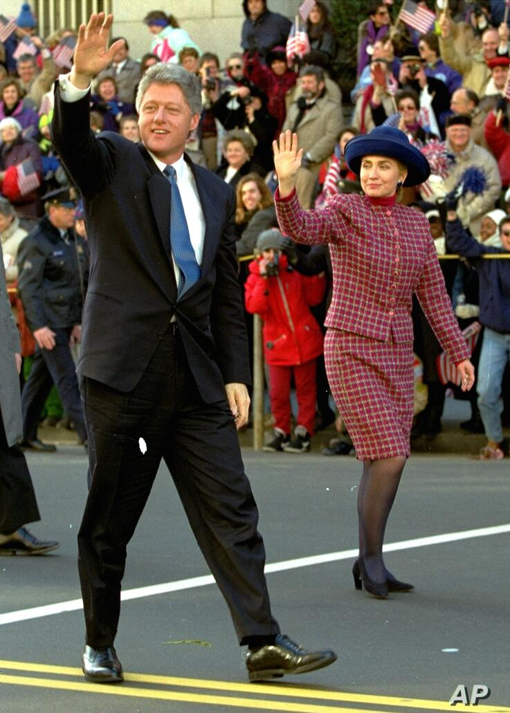 President Clinton and his wife Hillary Rodham Clinton wave to the crowd as they walk down 15th Street in Washington Wednesday,…