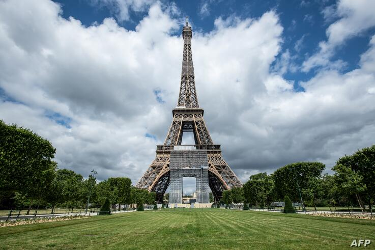 Picture of the Eiffel tower taken on June 15, 2020 in Paris, ahead of its partial reopening to the public as France eases…
