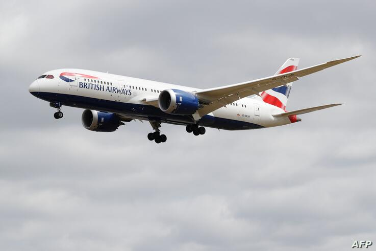 A British Airways Boeing 787 comes in to land at Heathrow airport in west London as the UK government's planned 14-day…
