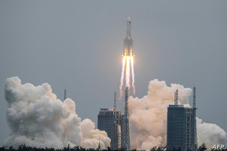 A Long March 5B rocket, carrying China's Tianhe space station core module, lifts off from the Wenchang Space Launch Center in…