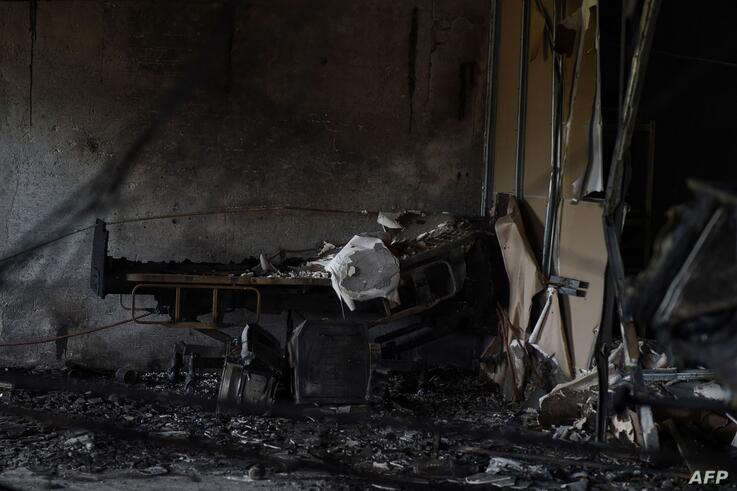 A charred hospital bed is seen at ward of the Patel Welfare Covid Hospital after a fire broke out overnight killing 16 Covid-19…