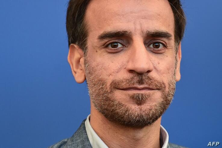 Member of the Orizzonti jury, Iranian director Shahram Mokri poses on September 1, 2021, during a photocall for the Orizzonti…