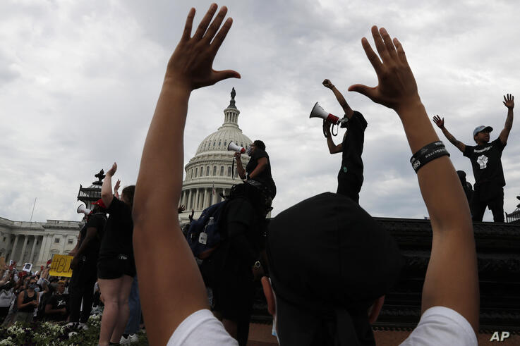 Demonstrators gather to protest the death of George Floyd, Wednesday, June 3, 2020, outside the U.S. Capitol in Washington…