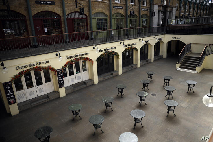 Tables stand empty, as restaurants and bars are closed due to the lockdown to try to stop the spread of coronavirus, in the…