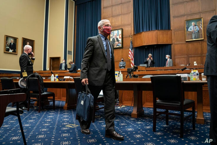 Director of the National Institute of Allergy and Infectious Diseases Dr. Anthony Faucileaves after testifying before a House…