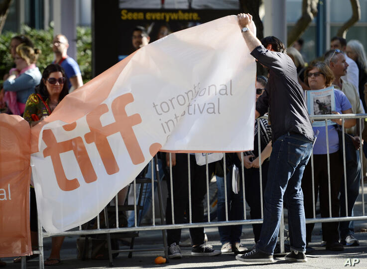 """A Toronto International Film Festival banner is laid down before a reunion screening of the 1983 film """"The Big Chill"""" on day…"""
