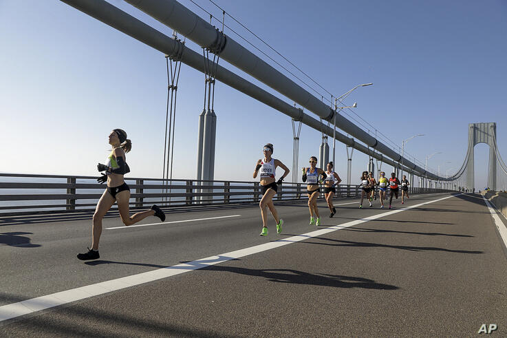 Competitors in the elite women's runners division make their way across the Verrazzano-Narrows Bridge during the start of the…