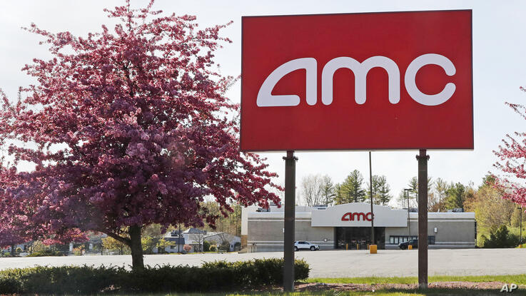This May 14, 2020, photo shows an AMC theater sign at a nearly empty parking lot for the theater in Londonderry, N.H. After…