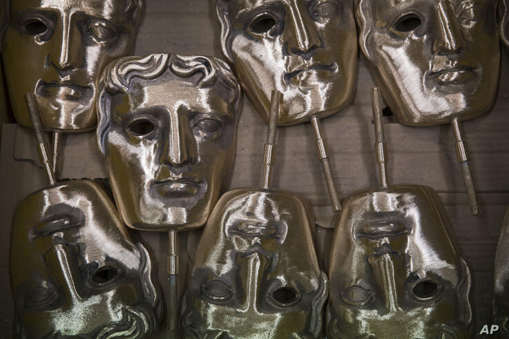 Bronze alloy masks lie in a foundry in West Drayton, Middlesex, Tuesday, Jan. 31, 2017, ahead of the award ceremony in February…