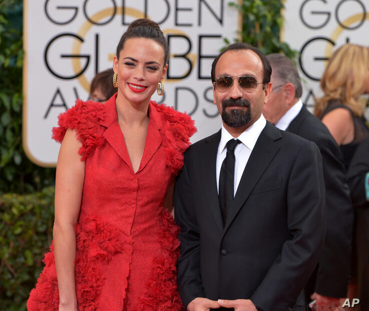Berenice Bejo, left, and Asghar Farhadi arrive at the 71st annual Golden Globe Awards at the Beverly Hilton Hotel on Sunday,…