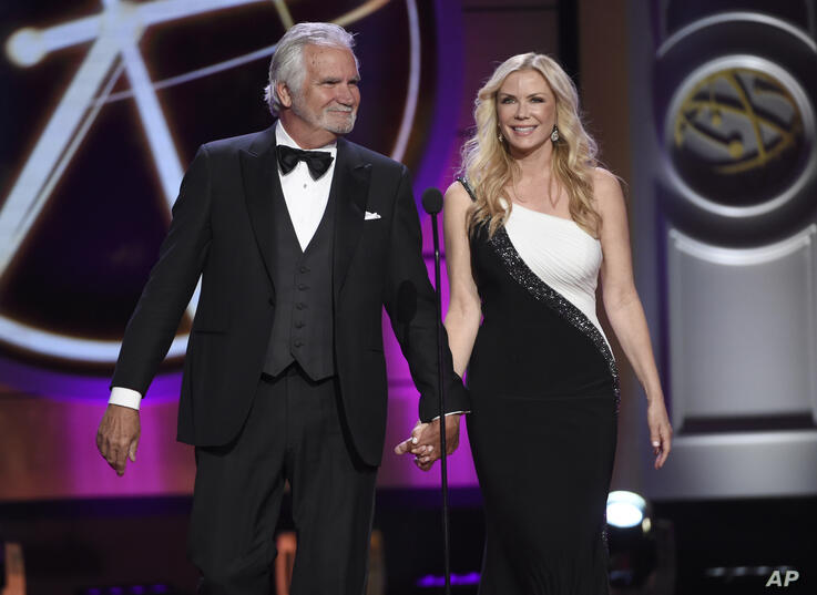 John McCook, left, and Katherine Kelly Lang walk on stage at the 44th annual Daytime Emmy Awards at the Pasadena Civic Center…