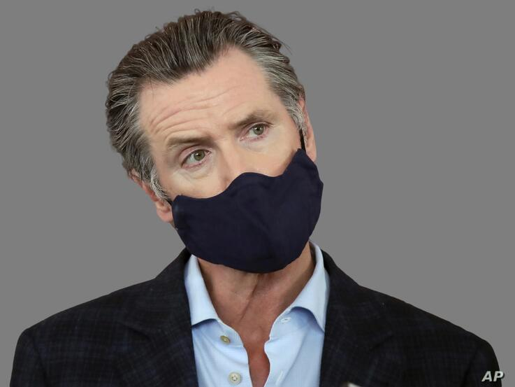 Gavin Newsom headshot, as California governor, wears a protective mask on his face while speaking, graphic element on gray