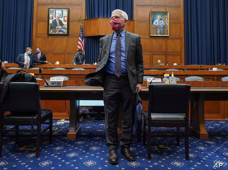Director of the National Institute of Allergy and Infectious Diseases Dr. Anthony Fauci leaves after testifying before a House…
