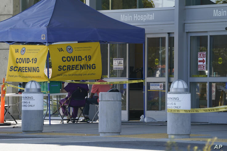 A COVID-19 screening site stands without anyone to be tested outside the VA Long Beach Healthcare System on Wednesday, June 10,…
