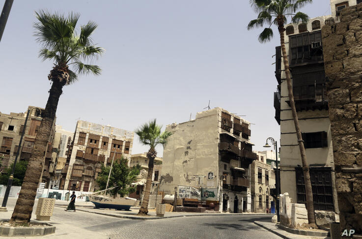 A person walks through the Jiddah's historical district, a UNESCO registered world heritage site, which is empty due to…