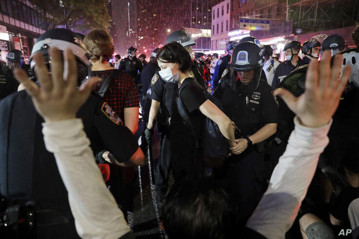 Police arrest protesters as they march through the streets of Manhattan, New York, Wednesday, June 3, 2020. New York City Mayor…