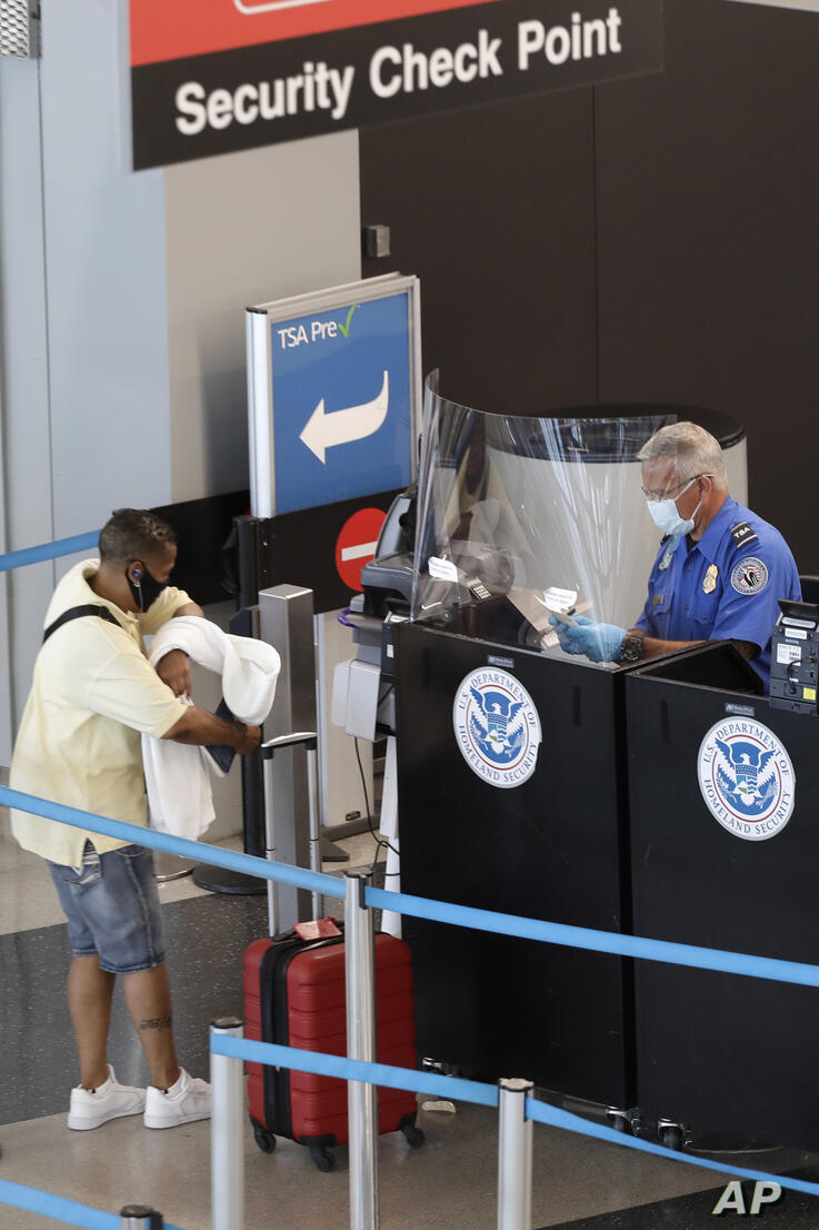 A Transportation Security Administration officer works at a security checkpoint at O'Hare International Airport Tuesday, June…