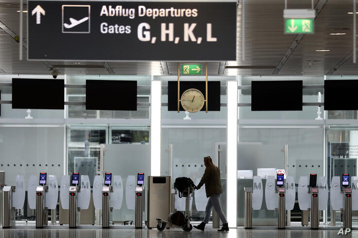 A passenger arrives at the security entrance at the airport in Munich, Germany, Tuesday, May 26, 2020. Germany on Monday…