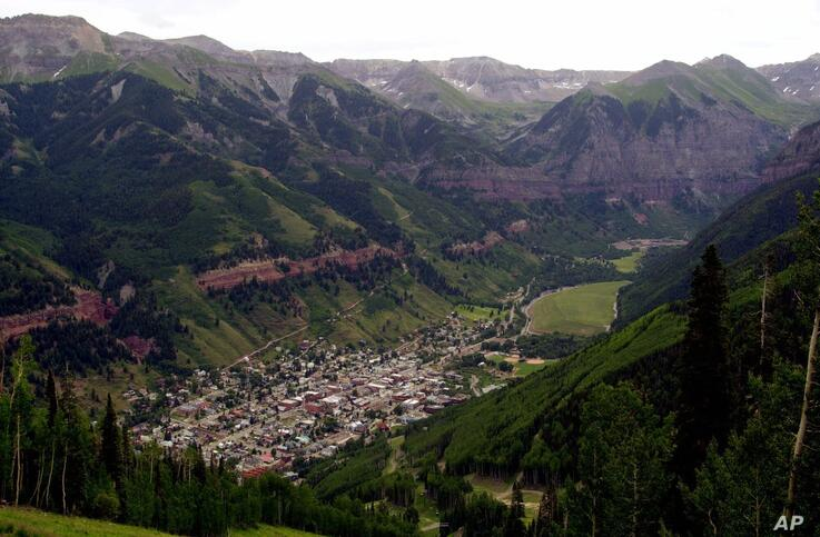 FILE - In this July 17, 2001, file photo, a view of Telluride, Colo. appears nestled in a valley from the top of Mount St…