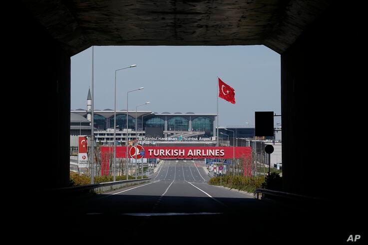 An empty road leading to Istanbul Airport, Sunday, April 19, 2020, on the second day of the two-day curfew declared by Turkey's…