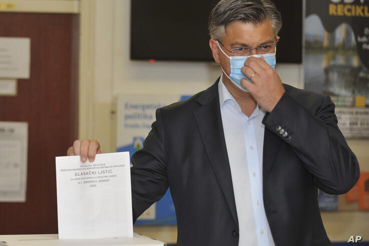 Andrej Plenkovic, Croatia's Prime Minister incumbent casts his ballot at a polling station in Zagreb, Croatia, Sunday, July 5,…