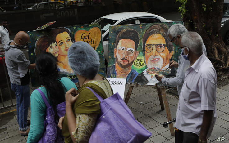 Artists from Gurukul art school make a painting of Bollywood superstar Amitabh Bachchan's family as they wish them speedy…