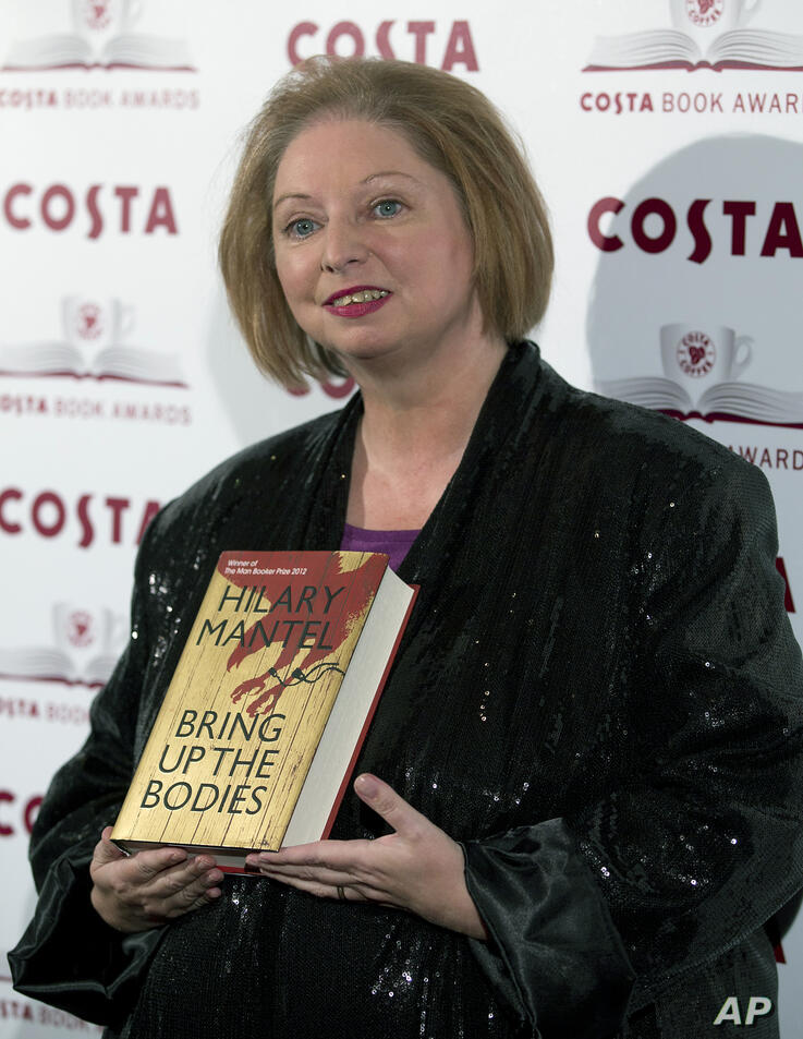 Author Hilary Mantel winner of the Costa Novel Award poses for photographers with her book 'Bring Up the Bodies' at the Costa…