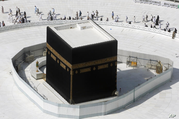 Muslims circumambulate the Kaaba, the cubic building at the Grand Mosque, in the Muslim holy city of Mecca, Saudi Arabia,…