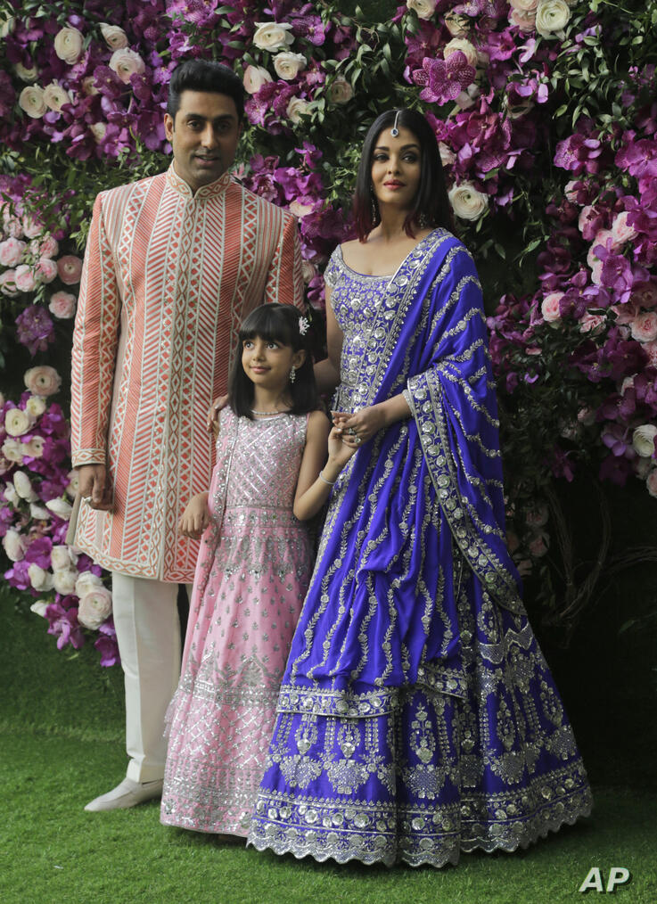 Bollywood actor Abhishek Bachchan, his wife Aishwarya Rai Bachchan and daughter Aradhya stand for photographs as they arrive…