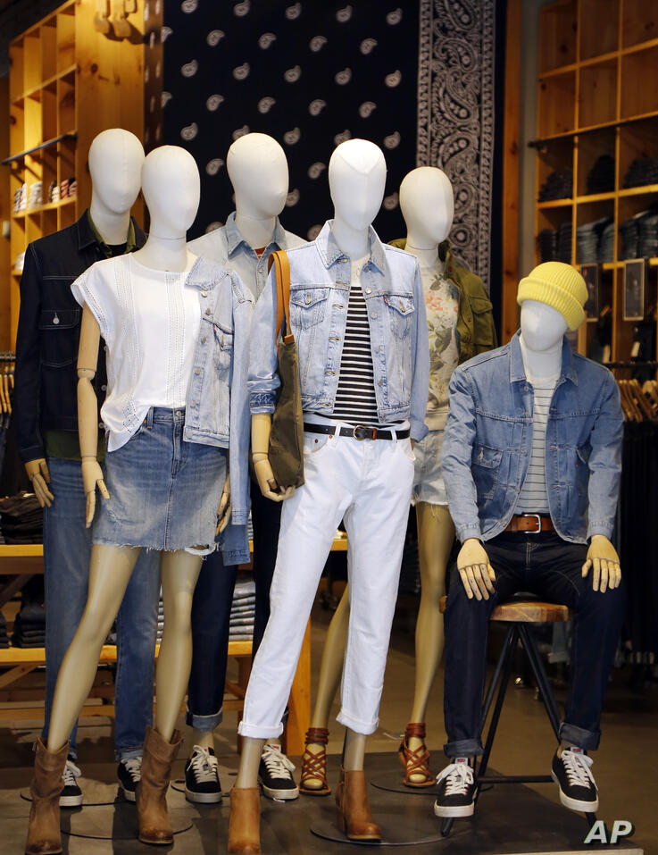 Levis fashions are displayed on mannequins in a Levis store, Wednesday, March 9, 2016 in New York. (AP Photo/Mark Lennihan)