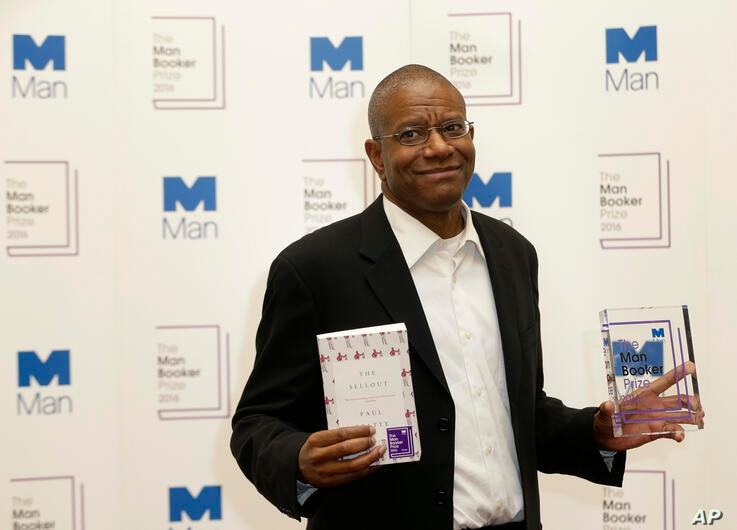 """Paul Beatty, from the United States, winner of the 2016 Man Booker Prize for fiction poses for the media with his book """"The…"""