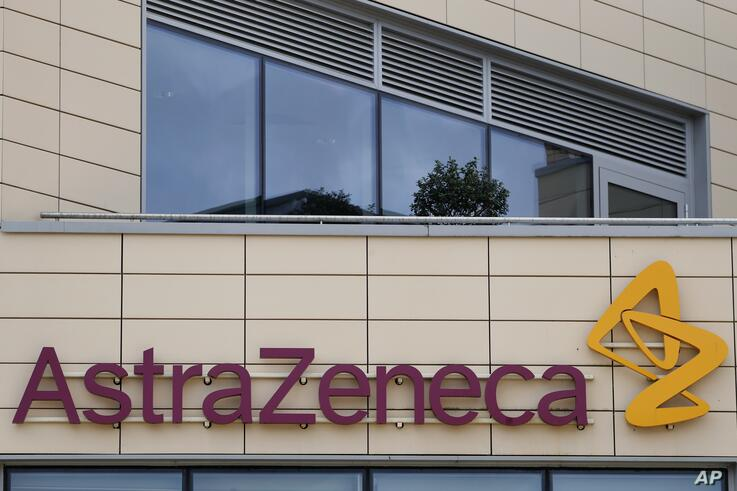 FILE - In this Saturday, July 18, 2020 file photo a general view of AstraZeneca offices and the corporate logo in Cambridge,…