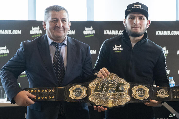 UFC lightweight champion Khabib Nurmagomedov, right, and his father Abdulmanap Nurmagomedov pose with the trophy belt during a…