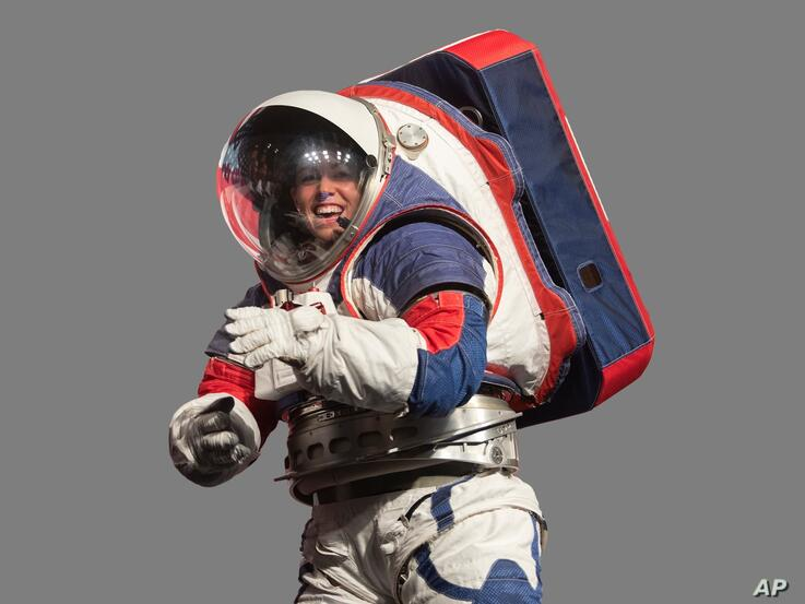 Kristine Davis, a spacesuit engineer at Johnson Space Center, wearing prototype of new NASA Exploration Extravehicular Mobility…