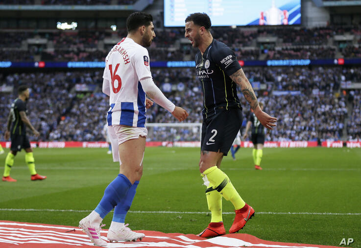 Brighton's Alireza Jahanbakhsh and Manchester City's Kyle Walker, right, go head to head during the English FA Cup semifinal…